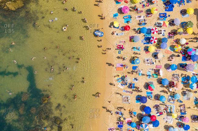 July 24, 2019: Aerial view of the beach shore in Praia do Camilo, Lagos, Portugal