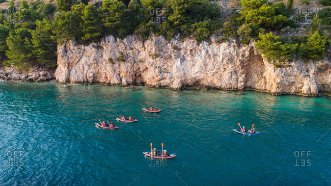 August 13, 2019: Aerial view of group of kayakers paddling near cliffs in Zivogosce, Dalmatia, Croatia.