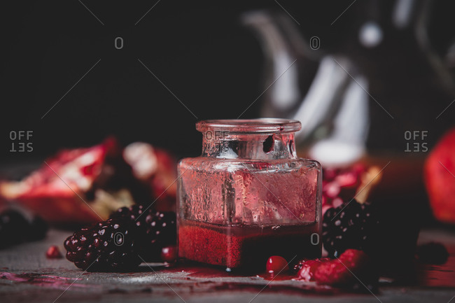 raspberry jam and jar on a table.