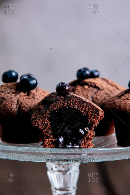 Chocolate Cupcakes with blueberries on a stand