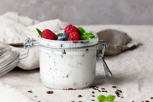 Ice cream with raspberries and blueberries on a table