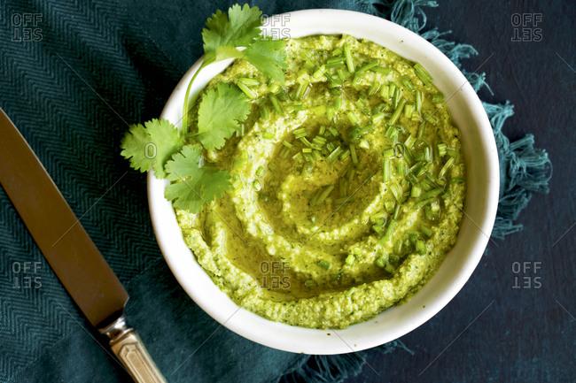 Overhead view of cilantro pesto in a bowl