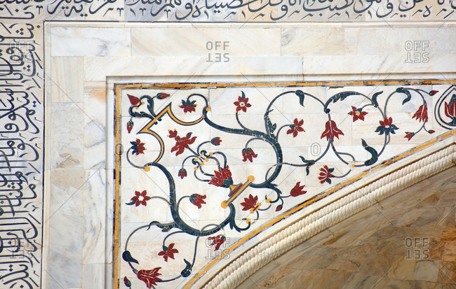 Agra, India - March 3, 2015: Close up of cut inlaid marble and script of the Quran.