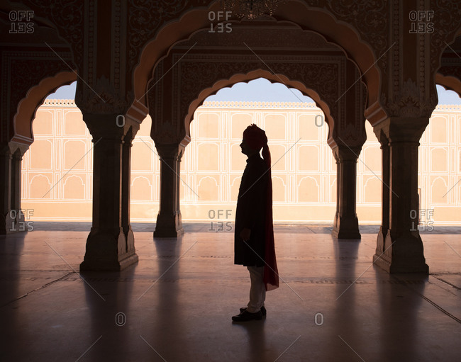 Guide for tourists standing at the City Palace in Jaipur, India