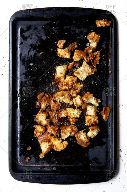 Rustic sourdough croutons on a roasting tin shot overhead,