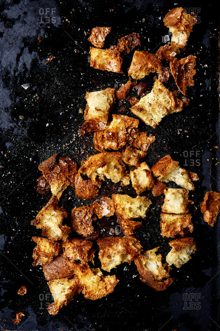 Rustic sourdough croutons on a roasting tin close up, shot from above