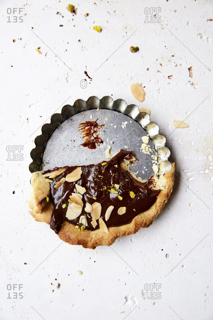 Half of a chocolate ganache in a baking tray on a white background,