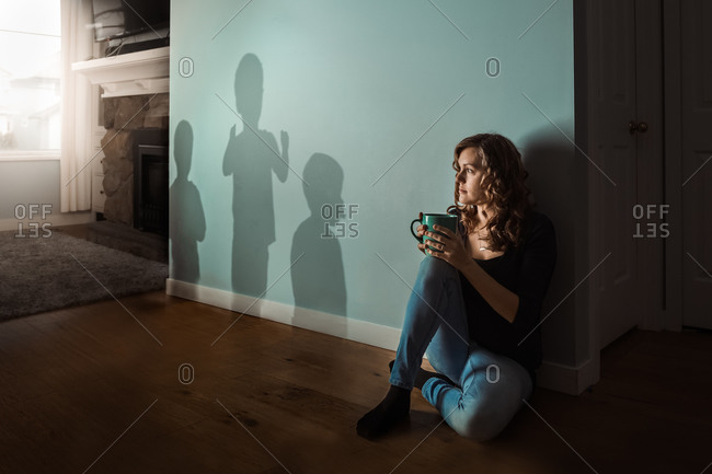 Mother watching shadows of her kids