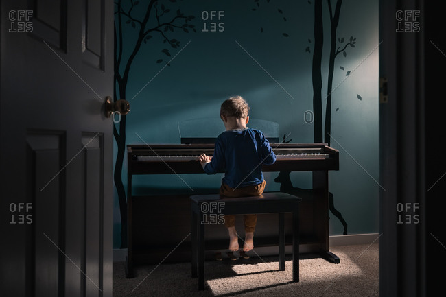 Young boy practicing piano in a calming room