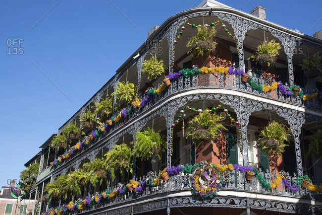 A building adorned with Mardis Gras decorations in New Orleans