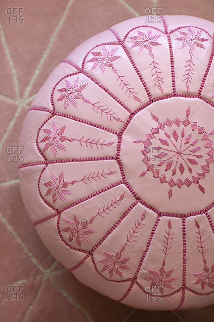 Pink cushion with threaded design