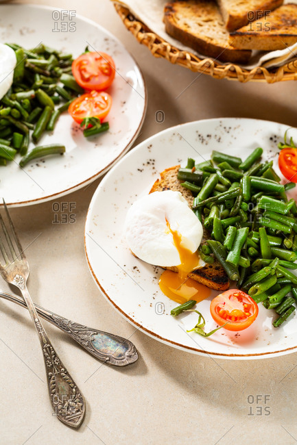 Poached eggs and beans on a plate