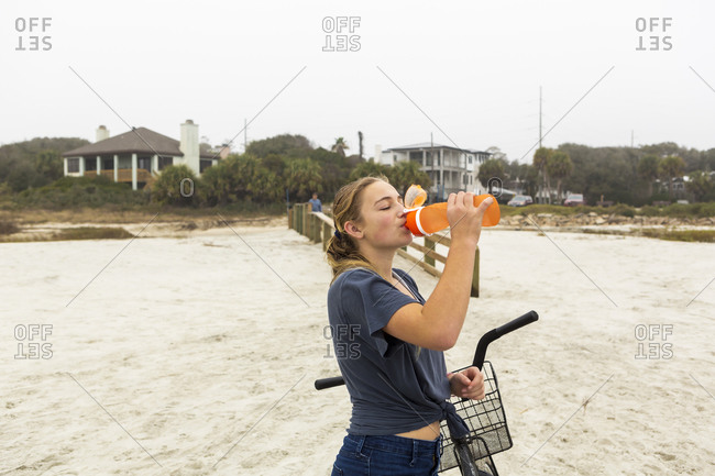 Teenage girl drinking water from a bottle