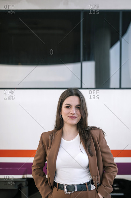 Portrait of Caucasian young woman next to a train car