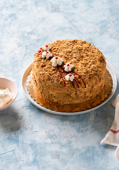 Russian honey layered cake (Medovik) on a blue table
