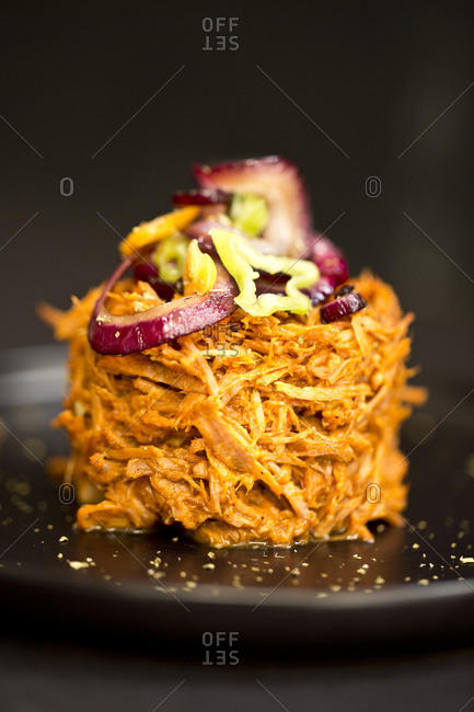 Tower of delicious Mexican cochinita pibil on a plate