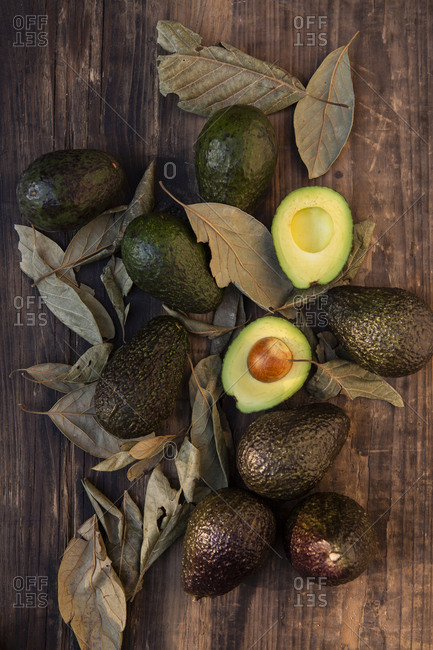 Overview of avocados over a wooden table