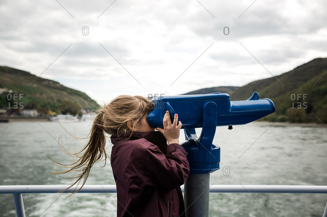 Girl using view to look out at ocean
