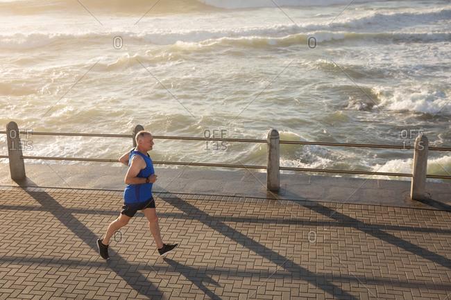 Jogger running on seaside