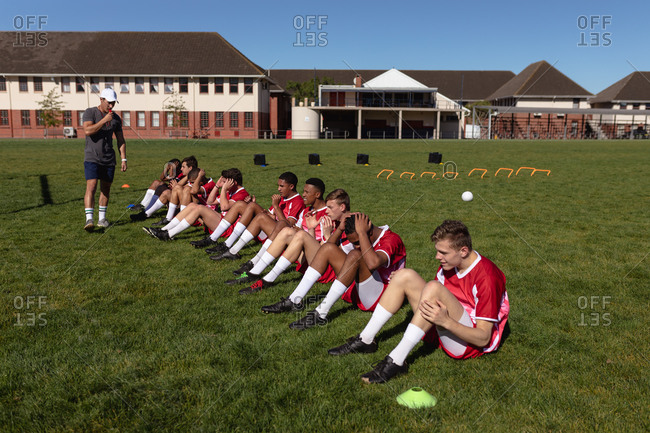 Rugby team doing abs on the playing field