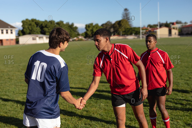 Rugby players shaking hands before starting a match