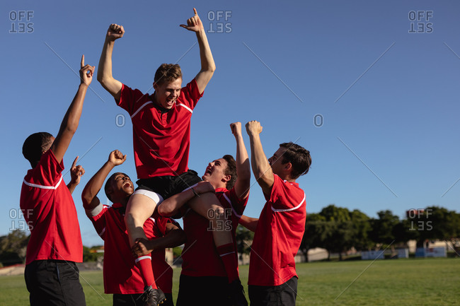 Rugby players happy together after a match