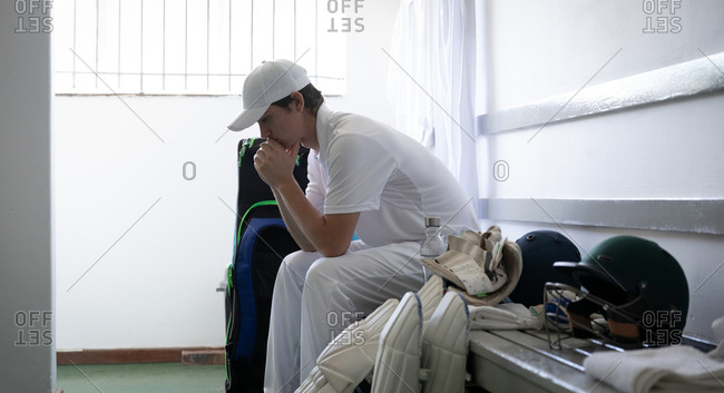 Man thoughtful before playing in the locker room