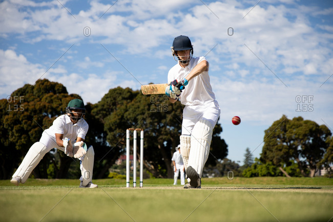 Cricket player shooting in the ball