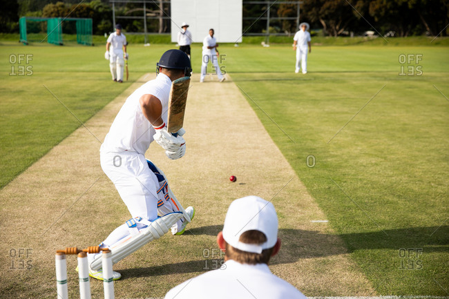 Cricket players training on the pitch