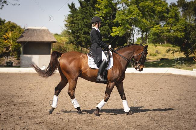 Caucasian woman riding her dressage horse