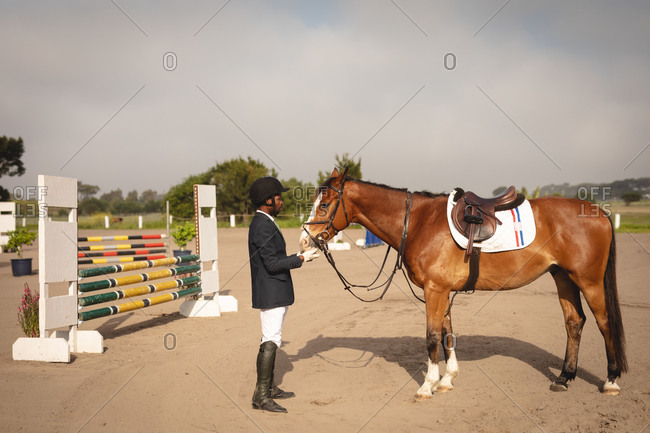 Man with his horse before dressage horse jumping event