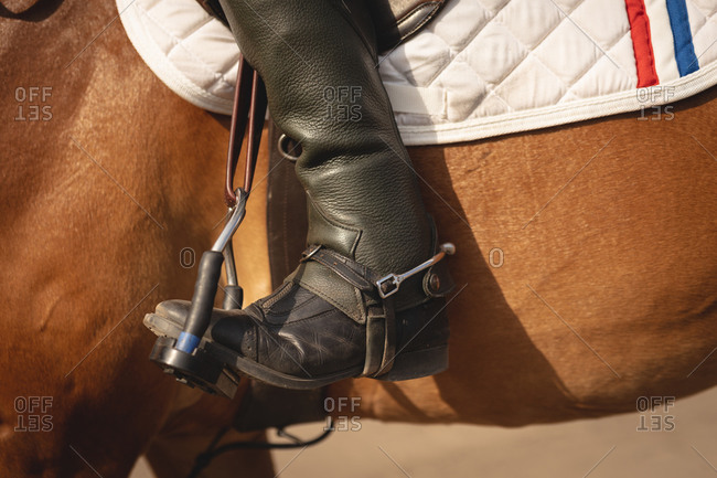 Close up view of man riding his dressage horse on a jumping event
