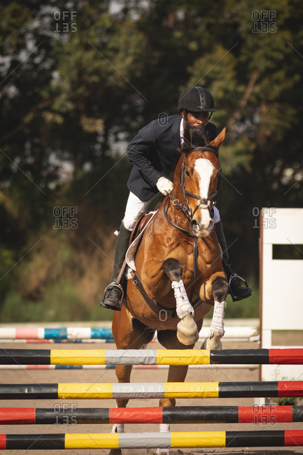 Man jumping with his dressage horse on a show jumping event