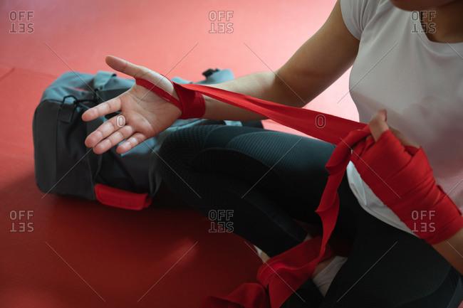 Judoka putting ribbon around her arm