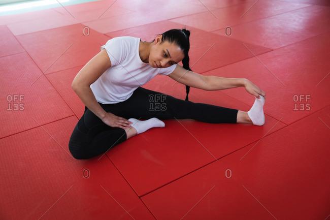 Judoka stretching on the mat