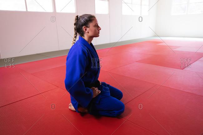 Judoka looking away in the gym