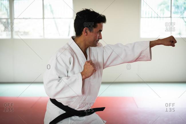 Judoka striking a pose in a gym