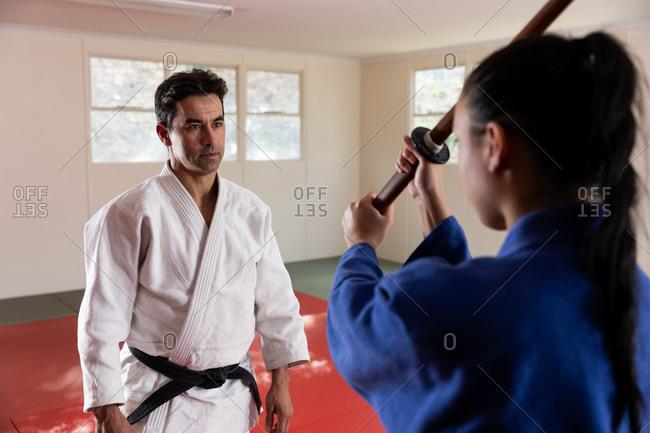 Judoka training with a saber