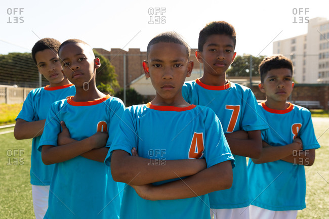 Front view of soccer team looking at the camera