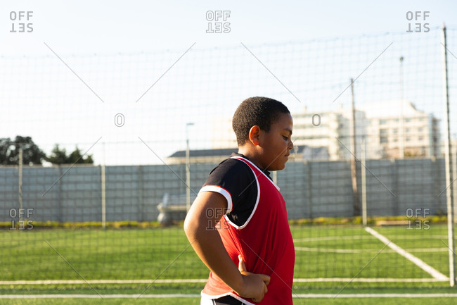 Side view of soccer player breathing