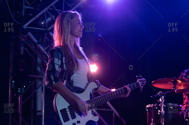 Guitarist performing in concert with her band