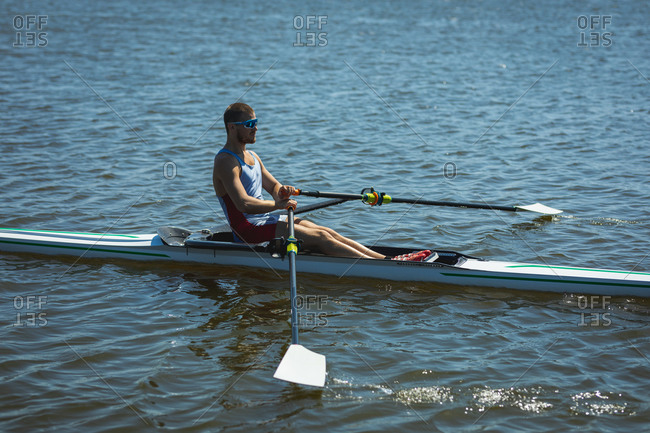 Caucasian man training a rowing boat