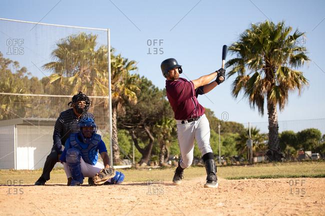 Baseball player hitting a ball during a match