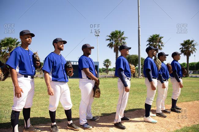 Baseball players standing on line