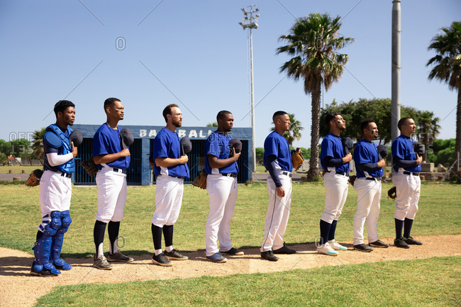 Baseball players standing on line