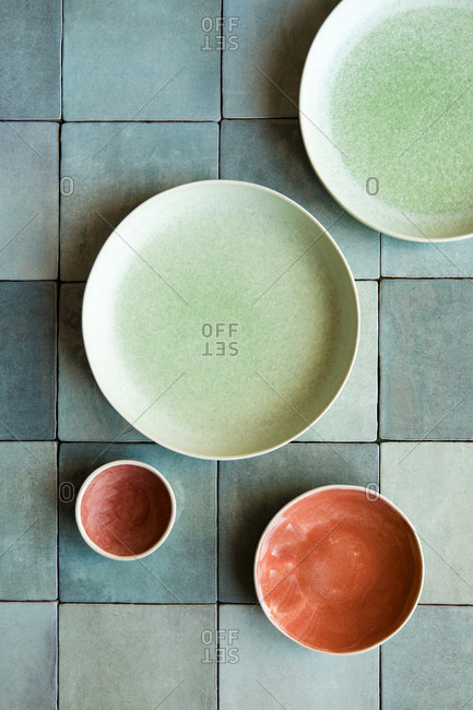 Tableware on colorful tiles - Offset