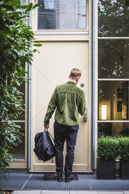 Male entrepreneur unlocking door - Offset