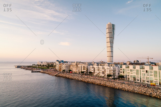 Sweden, Malmoe - February 20, 2020: Scenic view of turning torso in Malmo city against sky
