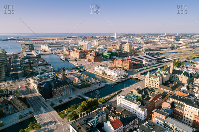 Sweden, Malmoe - February 20, 2020: High angle view of city landscape by sea against sky