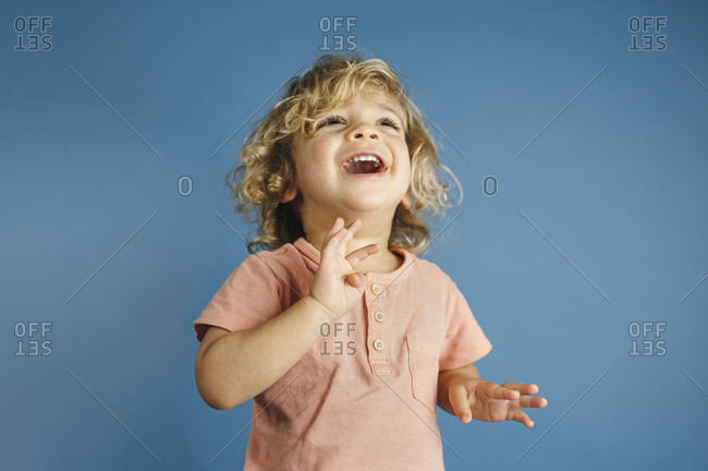 Portrait of happy young boy in a colorful environment